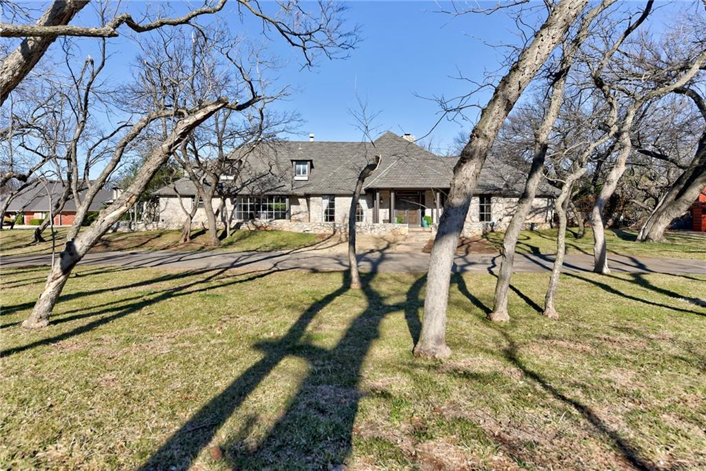 Rare Opportunity on a premier street in North Quail Creek on over 1 acre wooded lot. This classic home was built to entertain both inside & out! Double doors entry leads to a spacious living area overlooking the backyard and pool with covered patio. Gracious formal dining room with butlers pantry & storage. Fabulous kitchen featuring subzero, double dishwashers, double ovens and breakfast bar open to family room with cozy sunken lounge seating, fireplace and full bar. Beautiful hardwood floors leading to a spacious laundry room off the kitchen. Powder room and an additional full bathroom downstairs adjacent to the patio pool access. Grand owners suite features a private sitting area/study, 2 full separate bathrooms with nice closets. 3 nice sized bedrooms & 2 bathrooms upstairs plus a bonus room. Climate controlled 3 car garage with storm shelter. Full home generator. Front circle drive plus separate side drive provides ample parking. TONS & TONS & TONS of storage in this home.