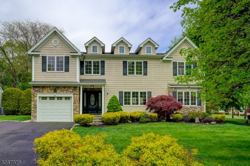 Welcome home to this gorgeous move-in ready newly updated 6BD/4.5BA center hall Colonial built in 2012 & situated on a quiet tree-lined street. Features include new casement windows, newly finished HW floors, neutral light fresh paint & designer lighting. Enter the dramatic 2 story foyer that leads to the formal LR w huge front window for an abundance of natural light & formal DR w french doors. Continue to the huge FR w gas FP open to the white eat-in kitchen w granite counters, SS appliances & sliders to the beautifully manicured fenced yard w sitting area & play set. 2nd floor is home to the MBR w lg walk-in closet, elec FP & spa like bath, 3 add'l BDs; 1 is an en-suite, main bath & laundry. Full finished basemnt in-law suite w gas FP, high-end laminate floor, 2 BBDs/office, rec room w wet bar & full bath