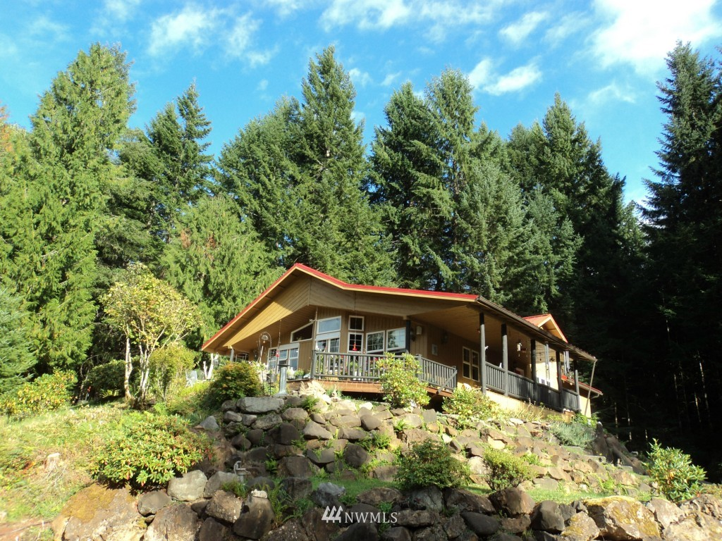 Terrific view of Tatoosh peak and surrounding Cascade foothills.  Borders National Forest and Coal Creek on back side.  Path through woods to swimming hole. Very private.  Large home has lots of room for everyone to visit.  Quality craftsmanship with many custom upgrades.  Close to Mt. Rainier National Park, White Pass Ski Area and the Goat Rocks Wilderness.  Year-round or vacation living at its best!  Timberline Village community has a pool and tennis court.  Basement fully finished.  Turnkey