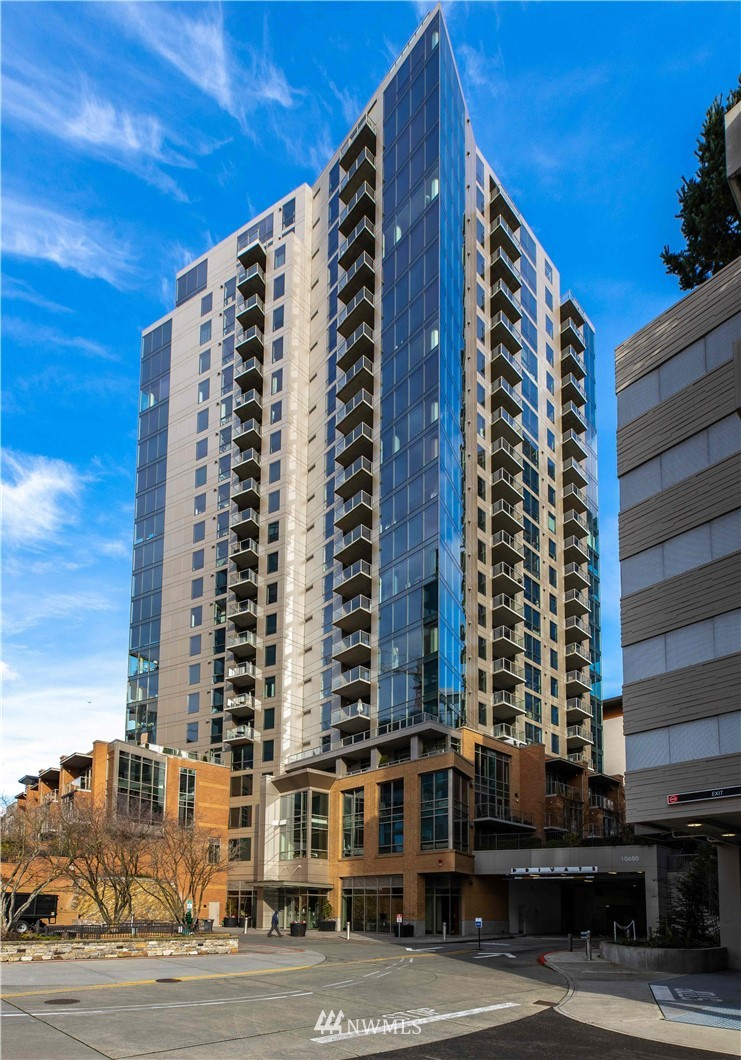 Luxury living in this one bedroom + den prime downtown Bellevue location. Upscale finishes with sophisticated lighting, gas fireplace, electric window coverings, built-in speakers and a TV that can be discretely hidden behind art. Enjoy a chef's kitchen featuring stainless steel appliances, gas range & granite counters. The tranquil bedroom features a walk-in closet with a custom closet organizer. Relax after a long day on the South facing balcony. Unit includes one reserved parking space plus a storage locker in the secured garage. Amenities include 24hr concierge, new fitness center, owner lounge and hot tub/spa. Electric vehicle charging available. Located in the heart of Bellevue next to shopping, dining & future Amazon office building.