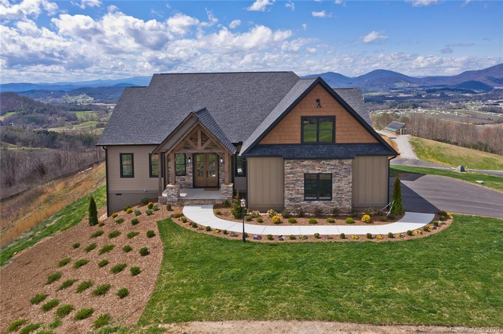 SIMPLY STUNNING MOUNTAIN RETREAT WITH MILLION DOLLAR VIEWS! This beautiful NEW 3 BR/2 BA, home has an open concept main floor featuring 10-ft ceilings and a beautiful stone gas FP. An amazing custom kitchen with high-end cabinetry and Bosch appliances, Wolfe gas cooktop, silestone island with fireclay farm sink, and large walk-in pantry complete this chef's kitchen. The dining room is defined by the accented wood ceiling. The master BR has two walk-in closets and an ensuite with custom vanity, granite countertop and a walk-in shower. Finishing the main floor is a second bedroom/guest suite with bath, a laundry room, mud room, office/den and exercise room.  Upstairs is a large bedroom/bonus room with lots of closet space. Just outside the 3-car garage is a whole house propane generator. The screened in back porch with brick flooring is perfect for watching fabulous sunsets over the mountain! Located an easy 15 min drive to Hendersonville shopping. Broker is related to seller