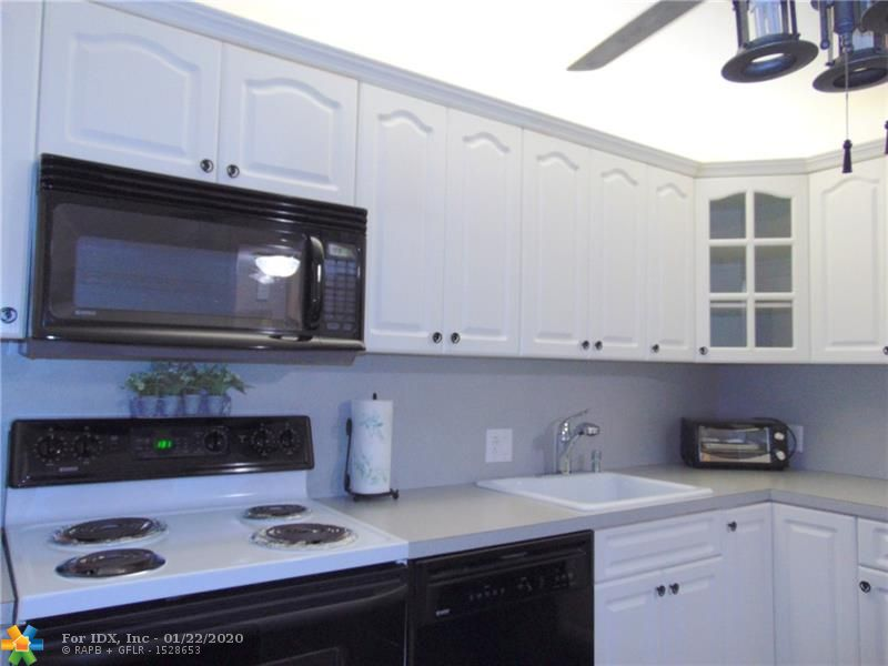 "SNOWBIRD IMMACULATE CONDITION. 1500 SQUARE FEET 3 BEDROOM 2 BATH CORNER CONDO. LIGHT BRIGHT & AIRY. BEAUTIFUL KITCHEN. LOADS OF WINDOWS. UPGRADED HUNTER DOUGLAS WINDOW TREATMENTS. TILED FLOORING. NO CARPET & NO LAMINATE.  PANORAMIC PUBLIC GOLF COURSE VIEW. COURSE WRAPS AROUND 2 SIDES OF BUILDING. NO GOLF MEMBERSHIP REQUIREMENT. MAGNIFICENT MOVE IN CONDITION. UPGRADED BATHROOMS. BEAUTIFUL EAT IN KITCHEN ""LOVELY TURN KEY FURNISHINGS ARE NEGOTIABLE"" VERY DESIRABLE PALM AIRE COUNTRY CLUB. LARGE BALCONY, GORGEOUS VIEWS. CLOSE TO TURNPIKE AND I-95, FORT LAUDERDALE INTERNATIONAL AIRPORT, STORES, RESTAURANTS BANKS AND SHOPPING NEARBY. GORGEOUS MATURE LANDSCAPING. SECURED LOBBY WITH TELEPHONE ACCESS....CALL ME NOW AND SEE, YOU WILL BE GLAD YOU DID."