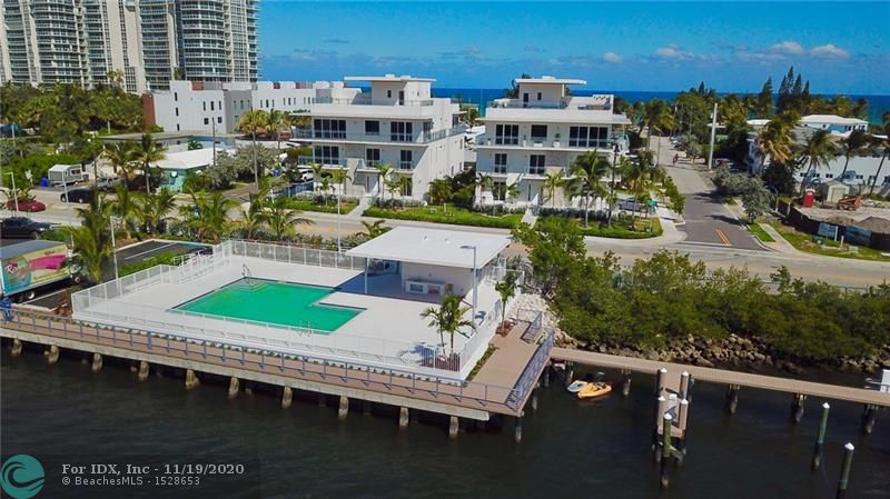 4000 sq.ft. A/C, ROOFTOP TERRACE, BOAT SLIP INCLUDED. Intracoastal and ocean views and located 1 block away from the beach. This luxury residence is one of 8 detached homes at Seaside Village, a boutique condominium along the Intracoastal on Hollywood's North Beach which features and waterfront pool deck and private marina. The homes have 3 levels of living space and a rooftop terrace with room for a hot tub and outdoor kitchen. These homes also feature a 2 car garage and an interior elevator. The low monthly maintenance covers homeowners, wind and flood insurance. Currently under construction.  Expected delivery Spring 2020.