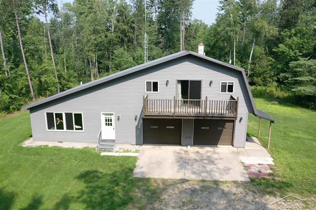 Are you are looking for that deer hunters paradise?? This property could be it and has it all on a beautiful 36 acre wooded parcel with pond! The three bedroom, 2 full bath, just over 1700 square foot home is a must see!! The home boasts two living spaces, main floor living area is all new with a  beautiful kitchen, eat at island, granite countertops, hardwood floors, stainless steel appliances, all that and a nice open feel. The furnace, central A/C, hot water tank and water softener are all newer as well. There is an attached 2 car (insulated and heated) garage, and two additional outbuildings, sizes 32x32 and 30x24, so plenty of room for all your hunting equipment, and toys etc. The 4 platform blinds stay with property. Property is located in an area that practices quality deer management. Come take a look, this should not last long!!!