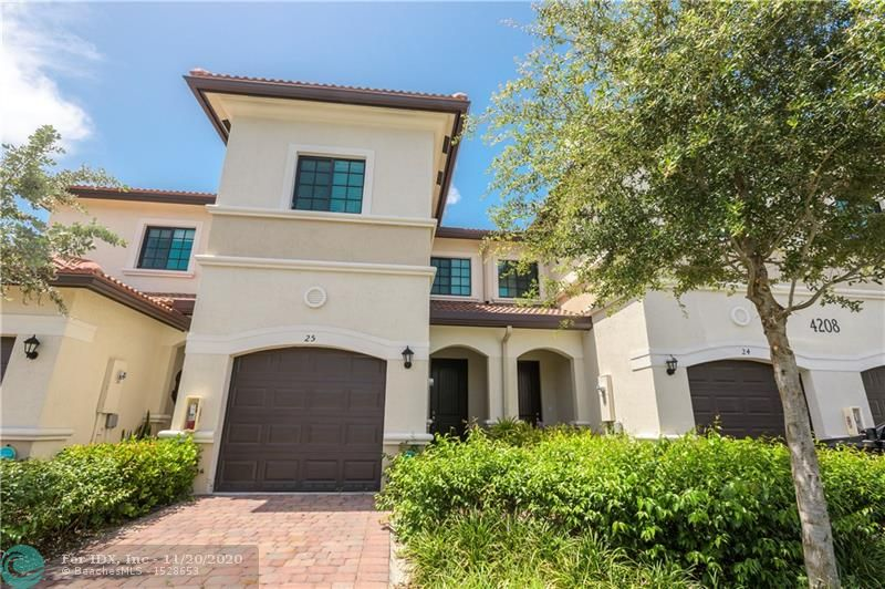 Townhome in Oakland Park Area with Impact Doors & Windows. Kitchen with Stainless Steel Appliances.    Spacious Master Bedroom with a walk-in closet, bath with shower, tub, and linen closet. Two other bedrooms carpeted, and has laundry room upstairs. Garage, Patio, &  Community Pool.  Great Energy from Nightlife to Coffee Shops to start your Day!