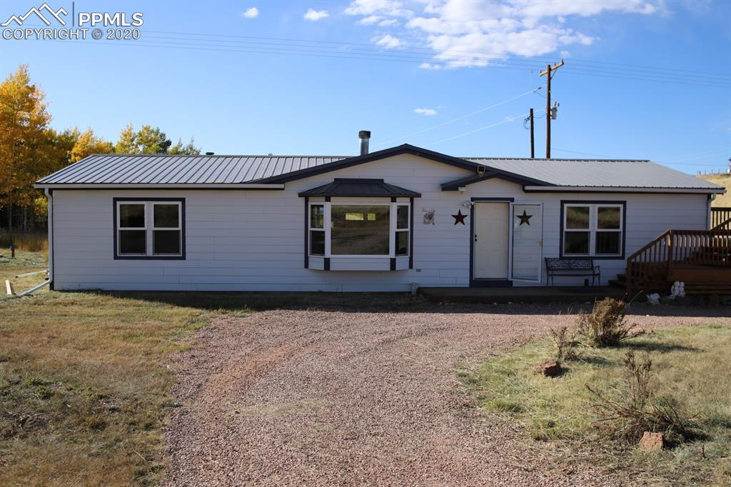 """This home is located in Beautiful Sherwood Forest. Gorgeous views of Pikes Peak and Aspen groves. Large Garage/Work Shop is on its own meter with 220v, partially insulated and concrete floor - Plenty of room to bring your Toys! (24'4"""" x 14'8"""" x 29'6"""") Inside the home, you will find a cozy living room overlooking Pike Peak from the bay window and a wood burning fireplace to keep you warm. Large open kitchen, spacious bedrooms and a large dining room. Sellers are providing a home warranty plan!!"""