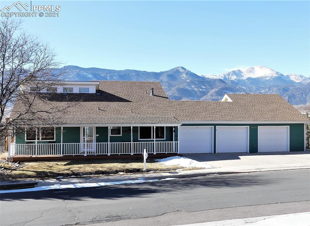 Exciting potential for a family suite/accessory dwelling unit /ADU! Panoramic North to South Pikes Peak, Garden of Gods, Red Rocks & Front Range views from the back of this Westside beauty! Clean & fresh, move in ready with new interior paint & trim. Main level: sunny & bright open floor plan with 18' high great room & gas fireplace with an attractive floor to ceiling stone fireplace hearth, connects to dining room/sunroom with panoramic views, spacious kitchen with granite countertops, breakfast bar,  & stainless steel appliances, lots of space in this 3+ garage with workshop & large storage room, 2 bedrooms+full bath with new tiled shower & main level laundry. Upper level has a private vaulted master suite, remodeled bath (marble double vanity, Manstone shower, + walk in closet). This is a unique property with lower level potential for accessory family suite/ADU. Walk out lower level, another sunroom with Pikes Peak views, living room with brick gas fireplace hearth, 1 bedroom, adjoining 3/4 bath (new tiled shower)  & walk in closet + game room with wet bar & 1/2 bath, kitchen, & laundry room with more storage. Lower level has NEW luxury vinyl plank flooring in kitchen & laundry room. Spectacular views from the 18' x 13' rear main level deck &  10' x 8' lower level patio. New stained 40' X 7' covered front porch. Clean hot water heat, 90 gallon hot water heater,  evaporative cooler, gas hook up for your outside grill, 2 kitchens, 2 laundry rooms, 2 gas fireplaces, 2 large sunrooms, wet bar, automatic sprinkling system, security system,  central vacuum (as is), & easy care wood laminate flooring. Short 5 minute drive to our famous Garden of the Gods Park & Red Rock Park with abundant walking & biking trails! Walk, bike, or drive to shopping & restaurants. This unique property has it all!