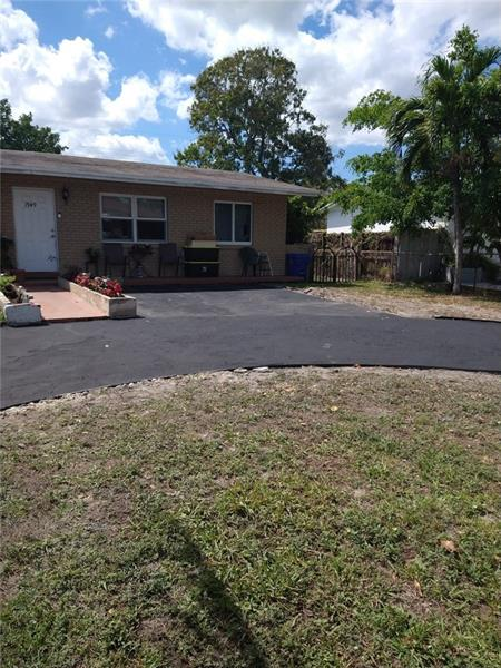 Updated home with a huge backyard in a quiet street in East Plantation. Tenant occupied can move out at any time.