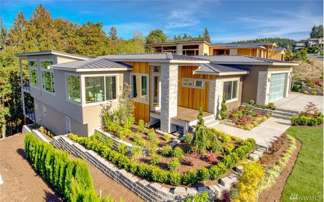 This new construction view rambler w/basement offers luxury living with combination of timeless, clean design & durability.   The Luxurious Grand Entrance will take you to your passage of wonders: Office, Living room, Chef Kitchen, Gorgeous covered patio with magnificent views of Seattle, Bellevue, Lake Washington. Other wonders: Master on main, California closet, quartz counter-tops, built-in wine bars, espresso machine, AC, second kitchen, master suite, home theater, 2 sets of washer & dryer.