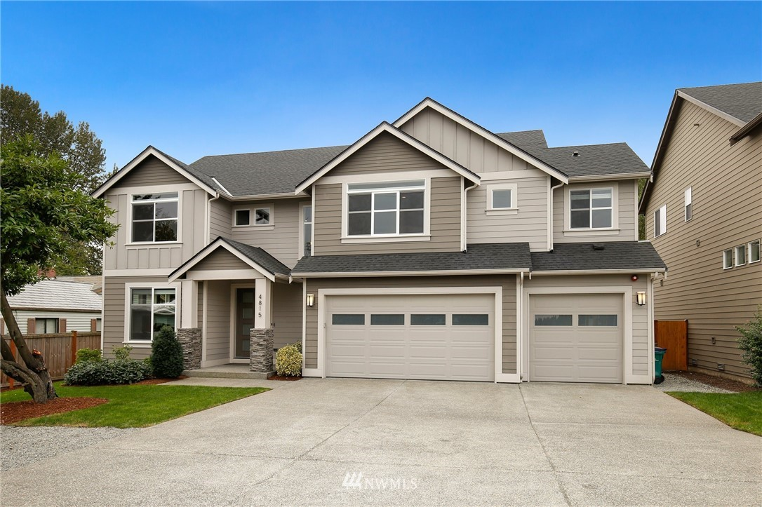 Wonderfully cared for home w/ 6 spacious bedrooms, 2.75 bath w/ 3 car garage. Less than 10min from Seatac Airport & Southcenter Mall. Min to the freeway 405, I-5, light rail. 15min from Seattle! Moving through the home you will find a thoughtfully designed flow and ample space to live/entertain. Open concept kitchen w/SS appliances. Hardwood floors. The main level bedroom can be used as a flex space: home school/office. Fully fenced yard. Backs up to green space. A/C! Smart connected home!