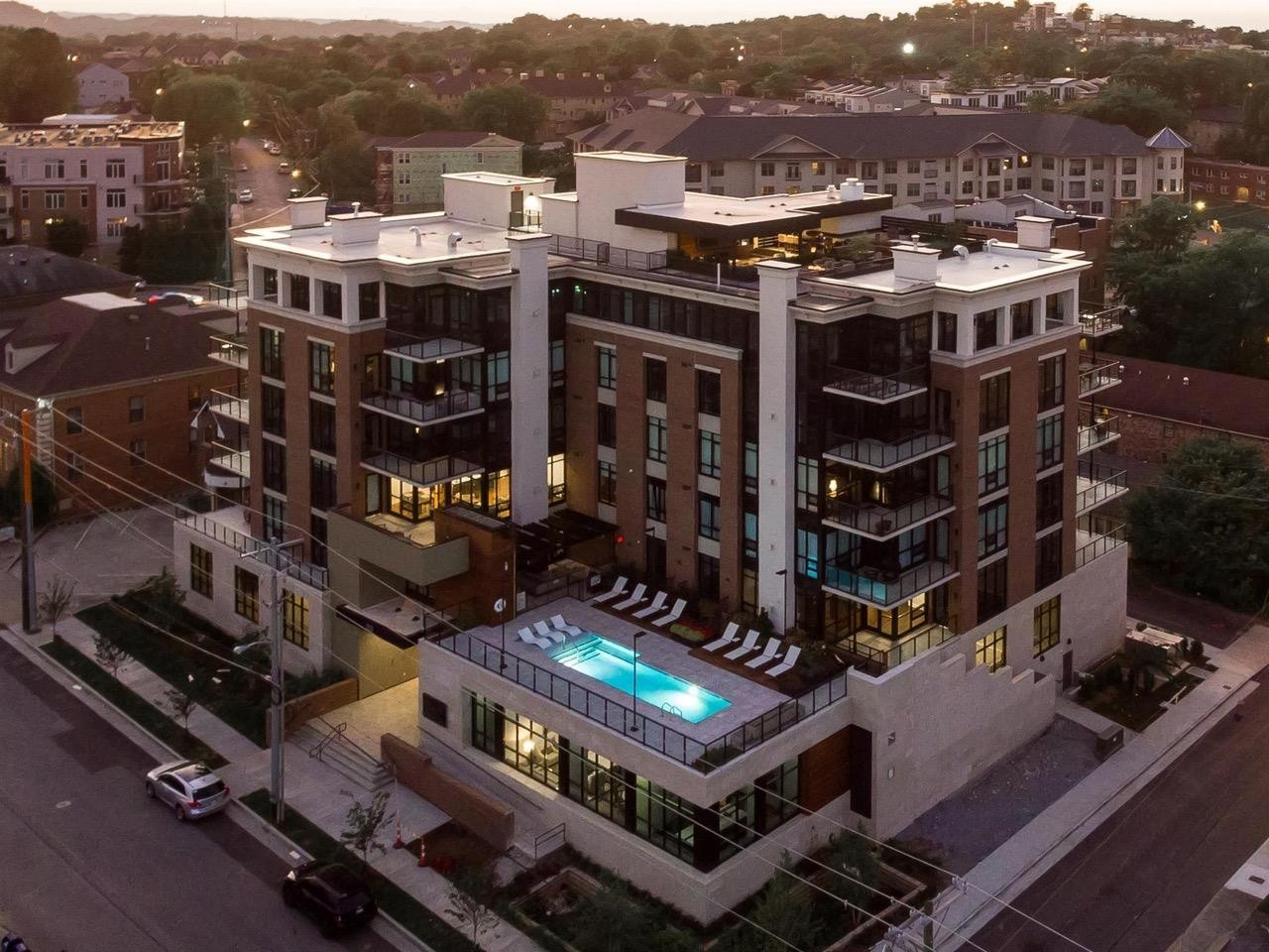 Views of downtown, Vanderbilt, and Centennial Park. Building is secure and has a parking garage with 2 assigned parking spots.  The Poston has a sky deck ( large enough to host parties), dog area, gym, pool, business rooms and resident lounge areas. Walk to restaurants, park, shopping. GREAT LOCATION!
