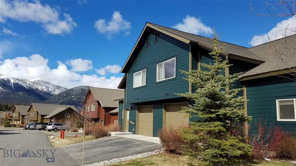 Beautiful, spacious 3 Bedroom, 3 bath, 1,859+/-Square Foot Firelight Condo located close to skiing and the Meadow Village.  Features include:  Soaring vaulted ceilings, open kitchen, great room, cozy wood burning fireplace, new flooring in all bedrooms, hallways, living room dining area. Separate laundry room/storage.  This immaculate condo comes furnished making this home the ideal Montana home, vacation rental or weekend retreat!