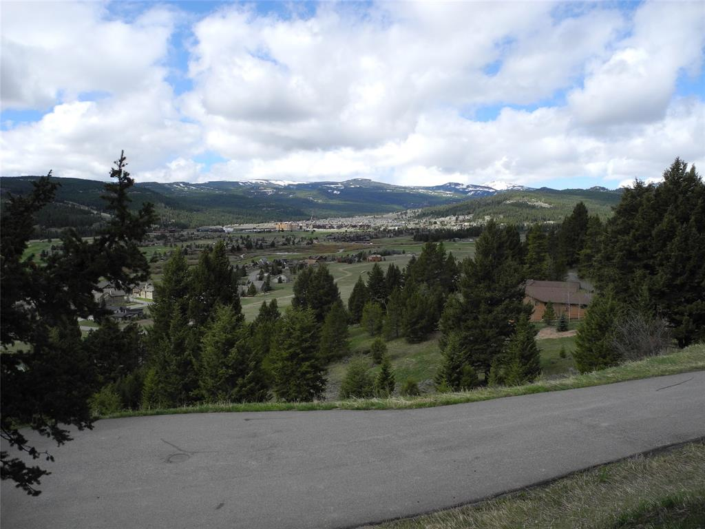 THIS SWEETGRASS HILLS 2.08 ACRE LOT IS LOCATED ON THE UPHILL SIDE OF THE ROAD AT THE END OF THE CUL-DE-SAC WITH GREAT SOUTHERN VIEWS OF THE MEADOW VILLAGE AND BIG SKY GOLF COURSE. THE PROPERTY BOARDERS BSOA OPEN SPACE, GIVING AN ADDITIONAL BUFFER TO PRIVACY.