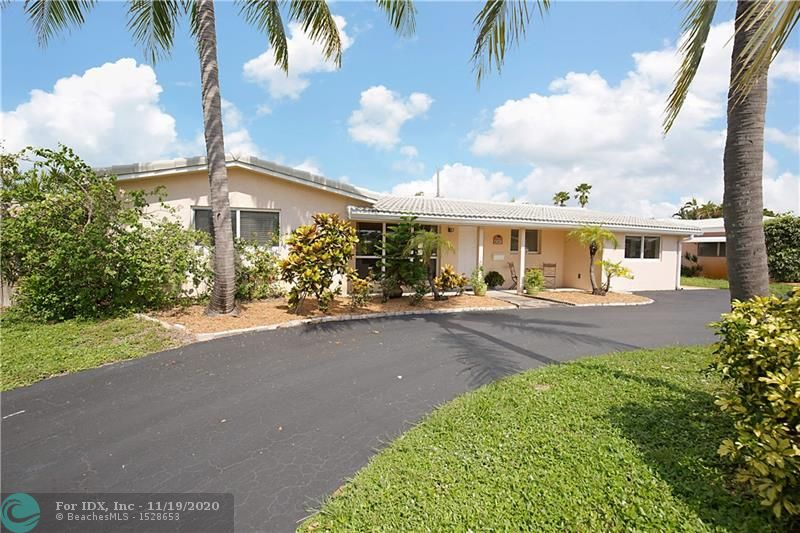 Bright, open four bedroom two and one half bath pool home in desirable Coral Heights section of Oakland Park. 