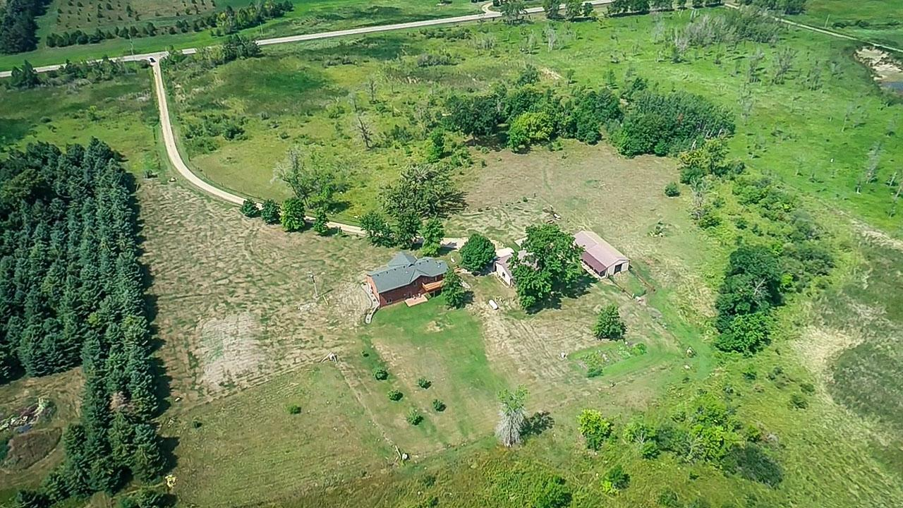 Great Opportunity to Own a Hobby Farm or Horse Ranch on 20 Private Acres with Beautiful Home & Barn! Home Features 4 bedrooms, 4 bathrooms, spacious layout, vaulted ceilings, 3 main floor bedrooms, laundry room, master bedroom with private bathroom and walk-in-closet, large office, living room and dining area.  Lower level has a walk-out basement, family room, bedroom, workout room and huge storage room. Plenty of room for all your toys in the oversized garage plus shed. Ideal property for horses and large animals with barn, stalls and fencing ready to accommodate your needs. Relax on the wrap around deck overlooking the private scenery with abundance of wildlife.  Endless possibilities with this property to fill all your hobbies from hunting, gardening, farming, trail riding and much more. This is a must see property in desirable location you are sure to appreciate.