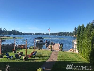 Fabulous waterfront! 3 bed 3 bath home on Spanaway Lake [motorized] w/den & loft. Gorgeous views/sunsets. Remodel in 2006. Gourmet Cherry & Granite kitchen w/all appliances. Cathedral Ceiling. Hardwood floors. Great rm w/gas fireplace & stone accents. Master on main floor w/5 piece bath. Heat pump=A/C & efficiency. Large den/theater or 4th bedroom. Lg wrap around composite deck. Hot tub. Fire pit. Huge concrete encased floating dock. Solar boat lift w/canopy. Surveillance System. RV Parking.