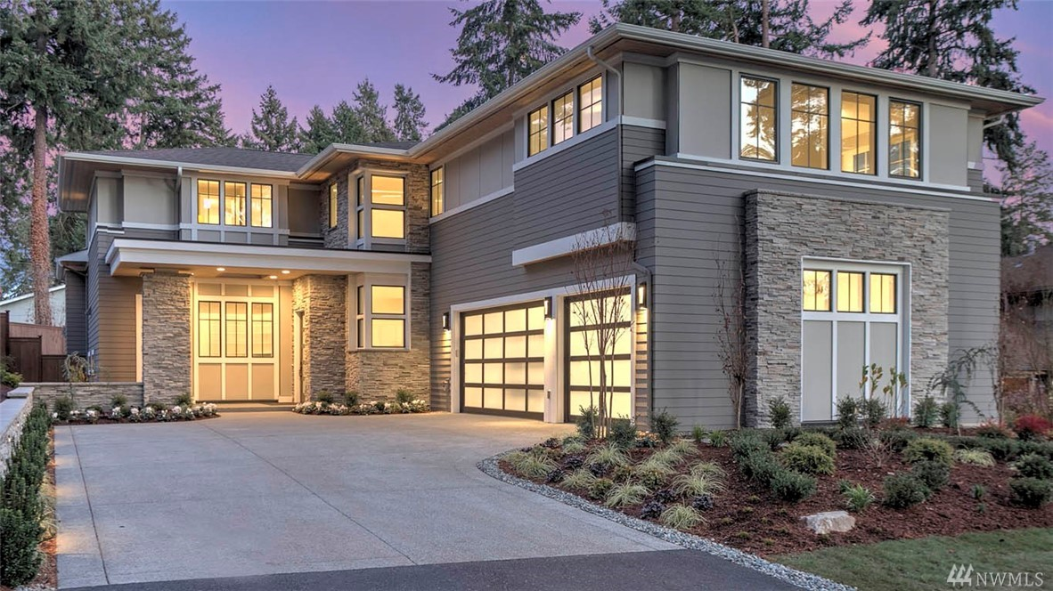 Design Build Homes presents custom luxury in West Bellevue. McCullough Architects plan features flowing great room with walls of windows & skylights w/ 4 guest suites inc. main floor guest suite. Chef's kitchen w/oversize island, Sub-Zero & Wolf appliances. Luxurious master w/spa-inspired bath & dressing room. Upper-level bonus or 5th BR. Enjoy outdoor living w/ kitchenette, BBQ, fireplace, heaters & skylights. Private, beautifully landscaped yard. 3-car garage. Excellent Bellevue schools.