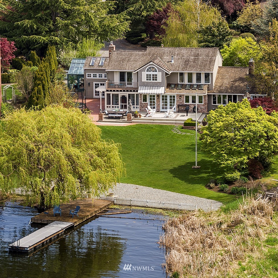 Discover storybook living on this rare, flat Lake WA waterfront in Bellevue's Newport Shores. Known for wildlife, eagles, dockside fishing & private, protected boat moorage, it's an entertainer's dream: Updated/timeless/remodeled: 1+acre & west-facing for spectacular sunset views. 4 bedrooms, 2 baths & laundry upstairs. All living on the main level: Kitchen•wine room•living/dining•rec room•steam room•greenhouse•office•family room & more. The careful design invites convenience & fun. A manicured setting with fruit trees & champagne grapes. Excellent location to Seattle & Bellevue's restaurants, businesses & award-winning Bellevue schools yet walk to Yacht Club w/marina, tennis, pool, volleyball. A resort lifestyle in the city! you've arrived