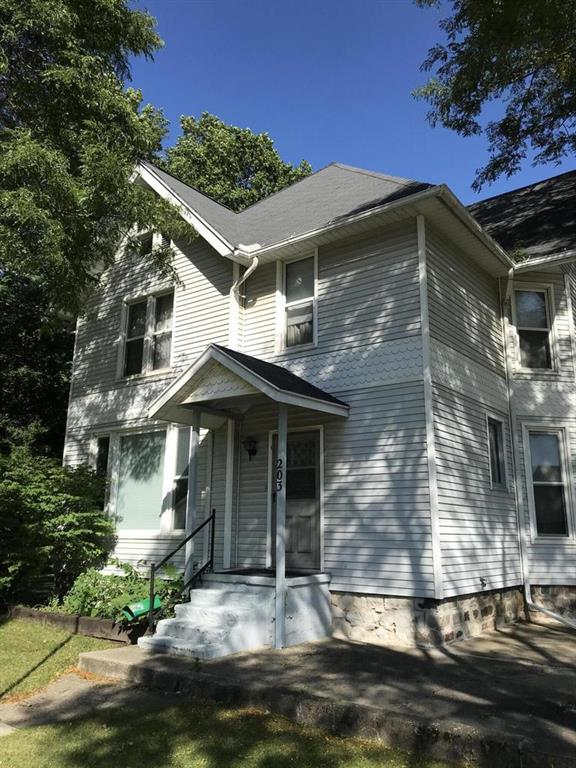 Beautiful woodwork and pocket doors throughout this 3 BR, possibly 5 BR, 2 full bath home on a corner lot in Reading.  Options are endless with the 2nd kitchen and family room upstairs along with two staircases.  Not to mention the 2 car garage and 2 car carriage house.