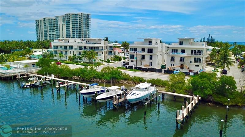 4000 sq.ft. A/C, ROOFTOP TERRACE, BOAT SLIP INCLUDED. NEW CONSTRUCTION UNDER $600/sq ft! Intracoastal and ocean views and located 1 block away from the beach. This luxury residence is one of 8 detached homes at Seaside Village, a boutique condominium along the Intracoastal on Hollywood's North Beach which features and waterfront pool deck and private marina. The homes have 3 levels of living space and a rooftop terrace with room for a hot tub and outdoor kitchen. These homes also feature a 2 car garage and an interior elevator. The low monthly maintenance covers homeowners, wind and flood insurance. Currently under construction. Only 3 left. Expected delivery Summer 2020. Showings available.  Please call listing agent to coordinate.