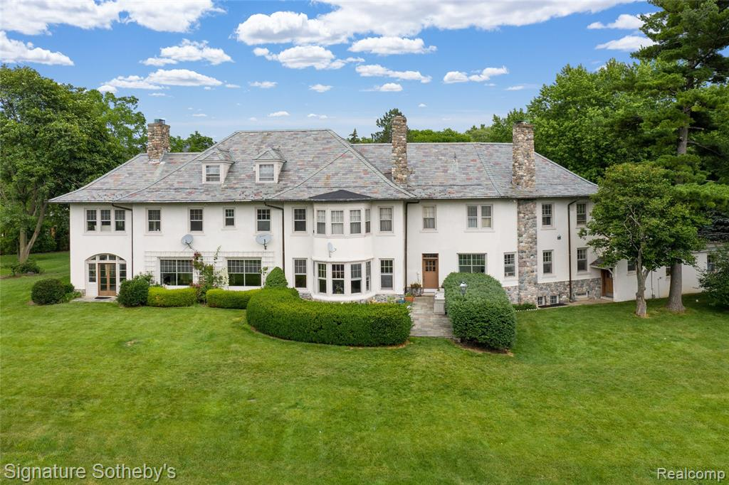 * 185 Dourdan was currently appraised at $1,937,000 = $137,000 of instant equity in this Albert Kahn designed estate, known by historians as the Heineman Estate, sits on an oversized lot on a private cul-de-sac Landscaping includes idyllic garden, lush vegetation, and pristine lawn. Kitchen includes Viking oven, built-in refrigerator, original butler's pantry, and opens to breakfast room. French doors separate two spacious living rooms with attached sunroom – perfect for entertaining. Master bedroom suite with fireplace, marble bath, and walk-in closet. Four additional bedrooms with Jack/Jill bathrooms; additional guest bedroom with full bath in separate wing. Home offices on first and second floors. Hardwood floors, high ceilings, antique chandeliers and sconces, and original molding throughout. Spacious finished attic space with cathedral ceilings can be used as an additional living space or game room. Oasis-like pool with attached spa, outdoor shower, and pool house with half bath.
