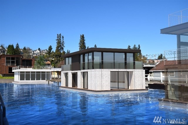 Stunning newly built architectural masterpiece at Stillwater Landing includes 1 car designated garage parking w/ 50 amp service & room for a boat alongside your home. Outstanding views of the Montlake Cut, Seattle Yacht Club, UW, Portage Bay water & mountain views. Fleetwood Sliders w/ expansive floor to ceiling design throughout, Liebherr & Miele appliances, his/hers master walk in closets, more. Exceptionally constructed w/ +/- 2,650 sq ft of living space + 800 sq ft roof top! Home Warranty.