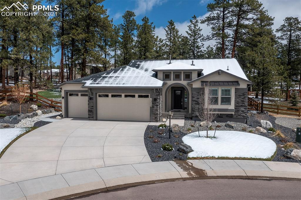 Immaculate Rancher in Sanctuary Pointe! This stunning home sits on a 0.40 acre treed cul-de-sac lot! This home features hand troweled textured walls, LTV flooring through the entire main level, two fireplaces, wet bar pre-plumb, central air, 10ft ceiling on the main level, and more! The kitchen is stunning with white cabinets, quartz counters, and a gas range. The master bedroom has plenty of space and walks-out to your 30x19 covered patio. The back patio includes a gas stub for your grill and a gas fireplace. All these amazing features plus easy access to I-25! This is a must see!