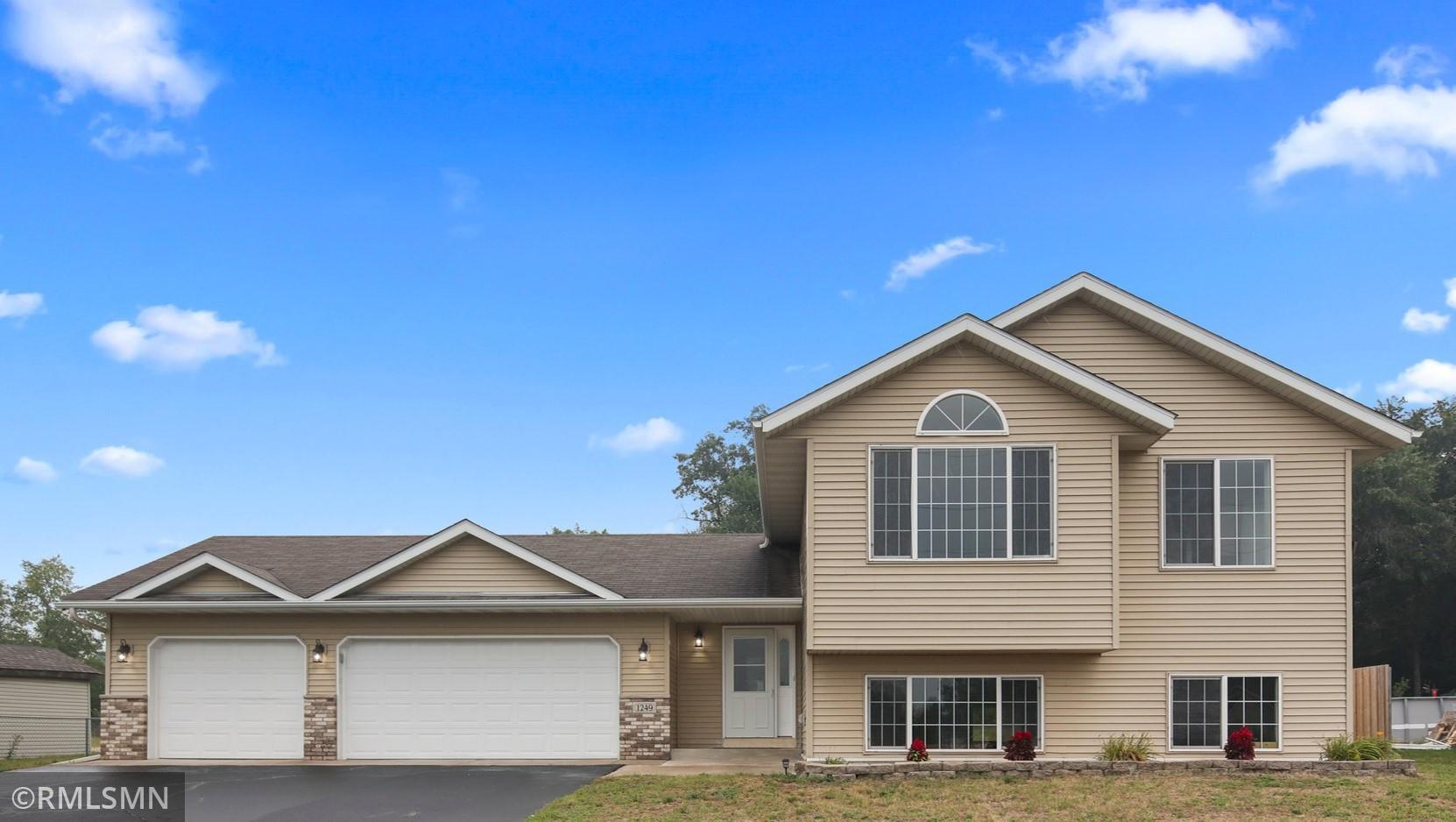 Newer home with a 3 car garage on a large city lot, with city services.  Turkeys and deer running in your backyard. Near HWY 10 for commuters.
