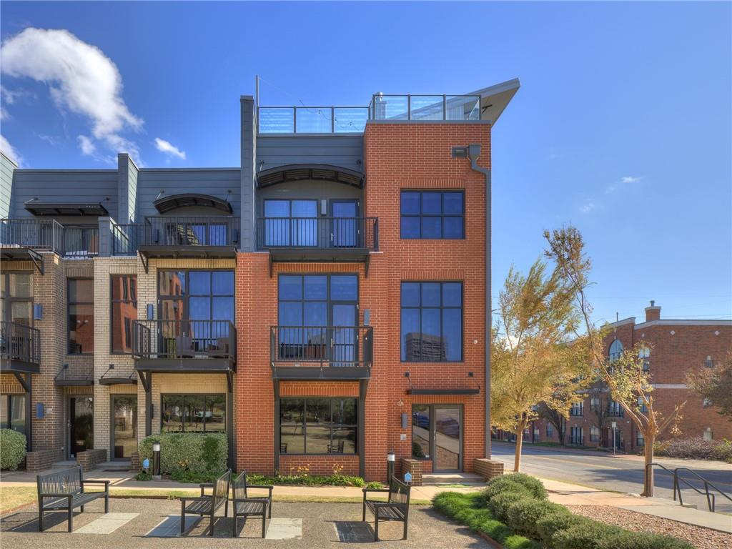 Wanting to live close to Downtown with walking distance to the nicest restaurants, Thunder games, or just general walkability throughout the city? This GORGEOUS Block 42 condo has everything you need! The tri-level modern townhouse, built in 2008, has every feature any buyer would want. The property features 2 Bedrooms, 3.5 Bathrooms, open entertaining layout, office/2nd Living, large walk in master closet, with a large open sun deck on the top floor with downtown & skyline views. The first floor features an office/2nd Living with a 2nd kitchen, full bath, & laundry area. The second level features an open living, dining, & kitchen concept with a powder bath, two sided fireplace & a balcony facing downtown views. The third level opens up to two larger bedrooms, both with ensuite bathrooms & walk in closets & another balcony. This unit also features an attached two car garage with gated parking & custom automated Lutron shades & lighting throughout. Buyer to verify school information.