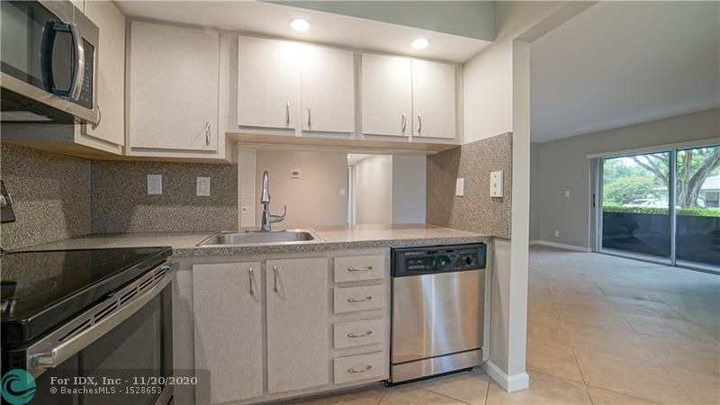 """Beautifully updated first floor condo in a relaxing waterfront complex - Lakes of Oakland Forest.  Two bedrooms/Two full bathrooms, Large living area, Large entry closet, Updated kitchen with stainless appliances, partial opening pass through to dining area. Full size washer/dryer and 20"""" tile floors throughout.  Master bedroom has a walk-in closet with built-in shelves. A/C replaced in 2018.  Screened patio off the living room.  Accordion hurricane shutters on windows & doors.  Close to Wilton Manors, Downtown Oakland Park, and the Beaches."""