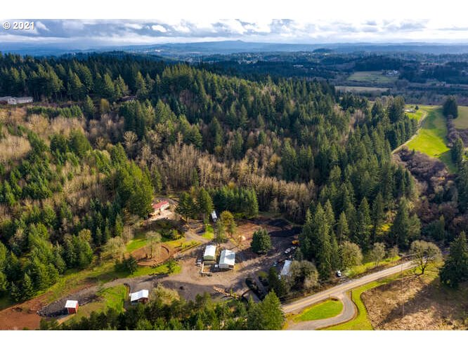 Up high in the middle of 17.29 acres of verdant rolling meadows & forest, Diamond Acres Estate is a vision brought to life: this extensively remodeled 5 bedroom charmer boasts commanding terrain views 5 mins to 205, new wrap-around decks, open kitchen with attached 5th bedroom/second kitchen, two-room cedar-lined Master Suite private pond, double gated entry & 7 outbuildings suitable for all kinds of country-life dreams. Lower level has separate access & kitchenette (possible ADU?). Must see.