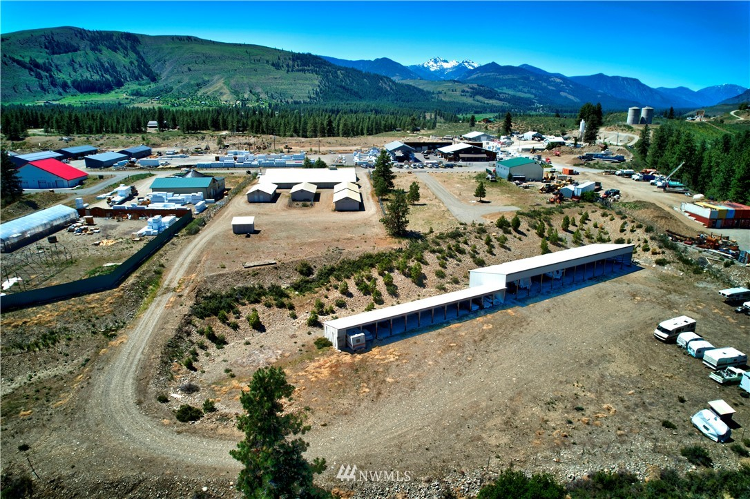 Incredible opportunity! Two well established and profitable businesses: Winthrop Mini Storage and Methow Ice located on 4.14 acres of prime light industrial zoned property in the town of Winthrop. Tons of room for growth of both business. Improvements include 3 phase power and recent hydrant placement allowing for future expansion. Office building contains: studio apartment, Methow Ice, Winthrop Mini Storage office takes two office units and Fresh Green(not included) takes the final space. Storage business has over 67 locker units of varying sizes, 12 10ft x18ft  carport units and 12 12ft x36ft RV/Boat open units. Don't miss out on this opportunity.