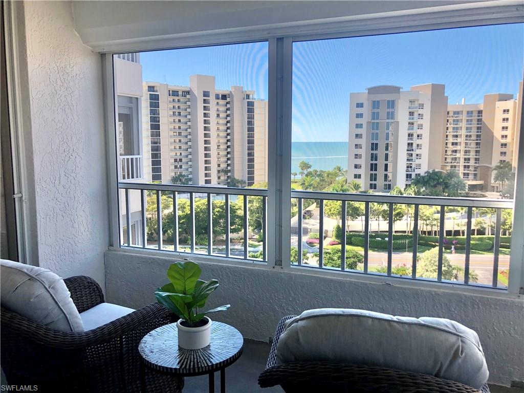 Enjoy sunrises over Vanderbilt Bay and sunsets over the Gulf of Mexico in this 8th floor end-unit in The Vanderbilt Landings. This condo residence has wraparound windows providing excellent panoramic views. Upgrades include black tile flooring and newly installed Berber carpeting, as well as black granite kitchen counter tops. The split-bedroom floor plan includes two bedrooms and two baths, a kitchen, a living room, a dining room, and two separate balconies — one with views to the east overlooking the bay, and another expansive wraparound balcony with views overlooking the Gulf. Electric shutters throughout provide ease and maximum storm protection.Vanderbilt Landings consists of 72 units in two buildings, and it provides a broad array of community amenities including pool, tennis courts, bocce ball courts, a chickee hut with barbecue, and boat slips available for rent. Directly across Gulf Shore Drive, The Landings community has private deeded access to the world-class beaches of Vanderbilt Beach, and also nearby is the Delnor Wiggins State Beach Park. This condo is available for short-term, off-season or annual rental. Rental rates will vary.