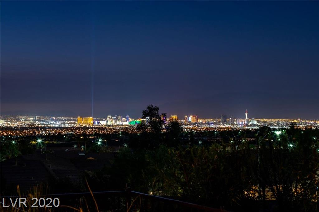 Perched high in the Black Mountains, this is one of the most desirable elevated lots located within Sun City Anthem. Perfect Golf Mesa Village location boasts sweeping views of the fabulous Las Vegas Strip, mountains, and twinkling city lights. The picturesque views are prominent throughout the interior and exterior. Sought after Gold Key Liberty model includes two full master suites. You will be amazed by the gorgeous curb appeal leading to the courtyard. The open concept floor plan is ideal for entertaining or relaxing with perfectly placed windows framing the views. Upgrades and options include stone pattern tile, stylish window coverings, and ceiling fans. There is also an oversized three bay garage including air conditioning and heating. You will love the quality and beauty of this home as well as the peaceful outdoor living space host to a covered patio, manicured landscapes, pond with waterfall, and the breathtaking views of the Las Vegas Strip, city lights, and mountains.
