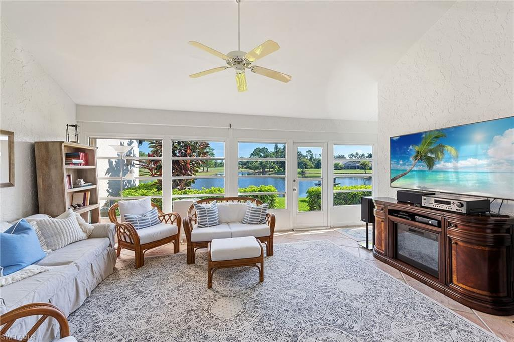 This villa lives like a single family home and is located in Old Lely and centrally located between downtown Naples and Marco Island. This unique home has phenomenal panoramic long lake views and is surrounded by rolling green hills of the freshly renovated Royal Palm golf course (membership optional). This home has wood flooring in main living areas and is perfect for entertaining from the eat-in kitchen, breakfast bar, and sprawling bright great room with 20' ceilings leading into the glassed-in air-conditioned Florida room. A unique screened in private courtyard atrium with a teak floor and an included private spa leads to the master bath. Loft bedroom with an enormous walk-in closet for plenty of storage. Plantation shutters on front windows and motorized hurricane shutters line all rear windows. New air conditioning system, tankless water heater, new roof, and new oversized Maytag washer and dryer. A detached garage is included and an additional assigned parking space is located adjacent to your door, plus plenty of guest parking. This great community has a swimming pool, and there are many planned social events during season. A must see!