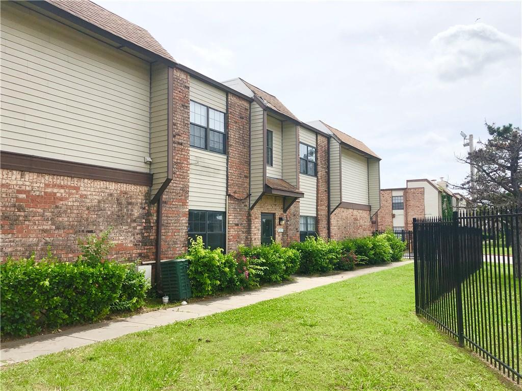 """Offers due by Wedn. 6/9 at 5pm. Come check out this downstairs condo with updated flooring throughout! Wood burning fireplace in living room. Good sized Dining room and galley kitchen with pantry and refrigerator included. Two Large bedrooms with plenty of closet space. Full bathroom in the hall and Master bedroom has a half bathroom attached. Condo is located in a nice part of the complex with easy access in & out. Complex is all electric, & water/trash is included in HOA fee, so owner only has electric utility bill. Selling in """"As-Is"""" condition."""