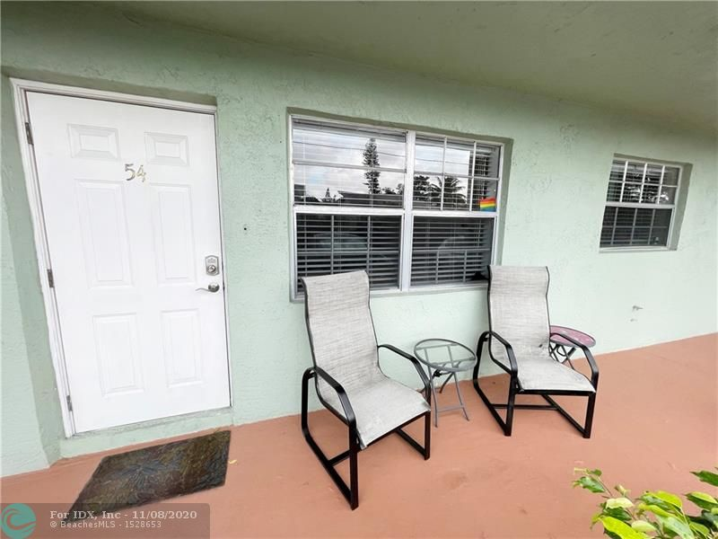 RENOVATED AND FURNISHED 2BR/1BA JUST STEPS TO ALL THE ACTION ON WILTON DRIVE!!! WOOD TILE FLOORING THROUGHOUT. NEWER AC AND WATER HEATER. GALLEY KITCHEN WITH STAINLESS STEEL APPLIANCES AND LOTS OF CABINETS. BUILT-INS. BRING YOUR SUITCASE AND START TO ENJOY THE SOUTH FLORIDA LIFESTYLE. COMPLETELY FURNISHED. PET FRIENLY COMPLEX. JUST STEPS TO THE HEATED POOL. INVESTOR FRIENDLY COMPLEX. RENT OUT IMMEDIATLEY OR GREAT SECOND HOME. WALK TO PUBLIX, STARBUCKS AND ALL THE HOT SPOTS ON WILTON DRIVE!!!