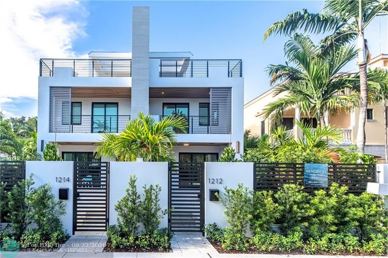 BRAND NEW! OVER 4500 SQ.FT. OF INTERIOR+EXTERIOR LIVING. AMAZING 3 STORY MODERN TOWNHOME INSPIRED BY ITALIAN ARCHITECTURE. LOCATED IN THE MOST DESIRABLE PART OF VICTORIA PARK. WALKING DISTANCE TO LAS OLAS SHOPPES AND RESTAURANTS AND MINUTES FROM FT LAUDERDALE BEACH. CUTTING EDGE OPEN KITCHEN BY PEDINI. QUARTZ COUNTERTOPS, LARGE ISLAND, AND BOSCH APPLIANCES. SPACIOUS MASTER SUITE WITH COVERED BALCONY+FREESTANDING TUB. 3 BEDROOMS, 3 AND HALF BATHS OF PERFECTION! 3RD FLOOR ENTERTAINMENT SPACE+BAR LEADING OUT TO STUNNING ROOF TOP TERRACE+ AMAZING VIEWS ACCESSED BY PRIVATE ELEVATOR. INCREDIBLE FLOATING CANTILEVERED STAIRCASE BY AMBIANCE INTERIORS. PRIVATE GATED COURTYARD W/POOL. ITALIAN PORCELAIN FLOORS. 2 CAR GARAGE. HIGH EFFICIENCY AC SYSTEMS, HURRICANE IMPACT WINDOWS AND DOORS. A MUST SEE!