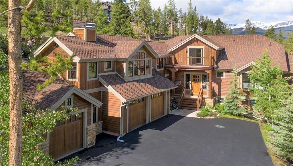 Beautiful, custom home with spectacular views of the Breckenridge Golf Course and the Ten Mile Range from nearly every room.  An expansive, open floor plan is perfect for entertaining with 4 fireplaces, vaulted ceilings along with custom wet bars on two levels and media and game room. Relax on the wrap around flagstone patio and enjoy the private hot tub after a busy day skiing.  Trail is steps away for biking and hiking, along with an oversize 3-car garage plus workshop, make this home a dream.