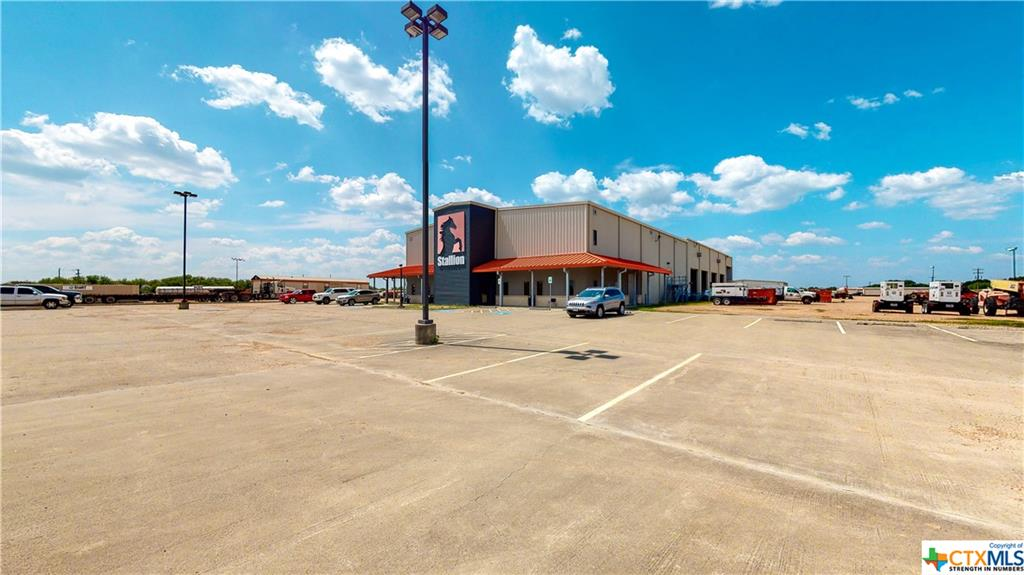 Prime Location on future I 69, with egress on Hwy 59 frontage road and Lone Tree Rd. Built in 2012 with two buildings. The main building has 16,900 sq. ft. of office space, 8,000 sq.ft. of enclosed shop and a 1960 Sq. ft. wash bay.   This building is two story with 8,450 on each floor, it has a lobby with enclosed reception office,  multiple executive and staff offices, three work pool areas, break room, copy/work room, storage, IT,  restrooms. 2nd Floor has conference room, training/meeting room, offices, break room, copy area, work pool area & restrooms. An elevator and two sets of stairs connect the floors. Shop Main building is 8,000 sq. ft. with a 10 ton walk over crane over two bays, 8 automatic overhead doors  and approx. 1,960 sq. ft. wash bay with floor drain. The second building has 10,631 Sq Ft of Shop and 1,630 sq. ft. in office space.  This building has 5 overhead doors, a laundry, locker room, multiple offices, and break room. The Fuel Island has 3 tanks and 4 pumps.