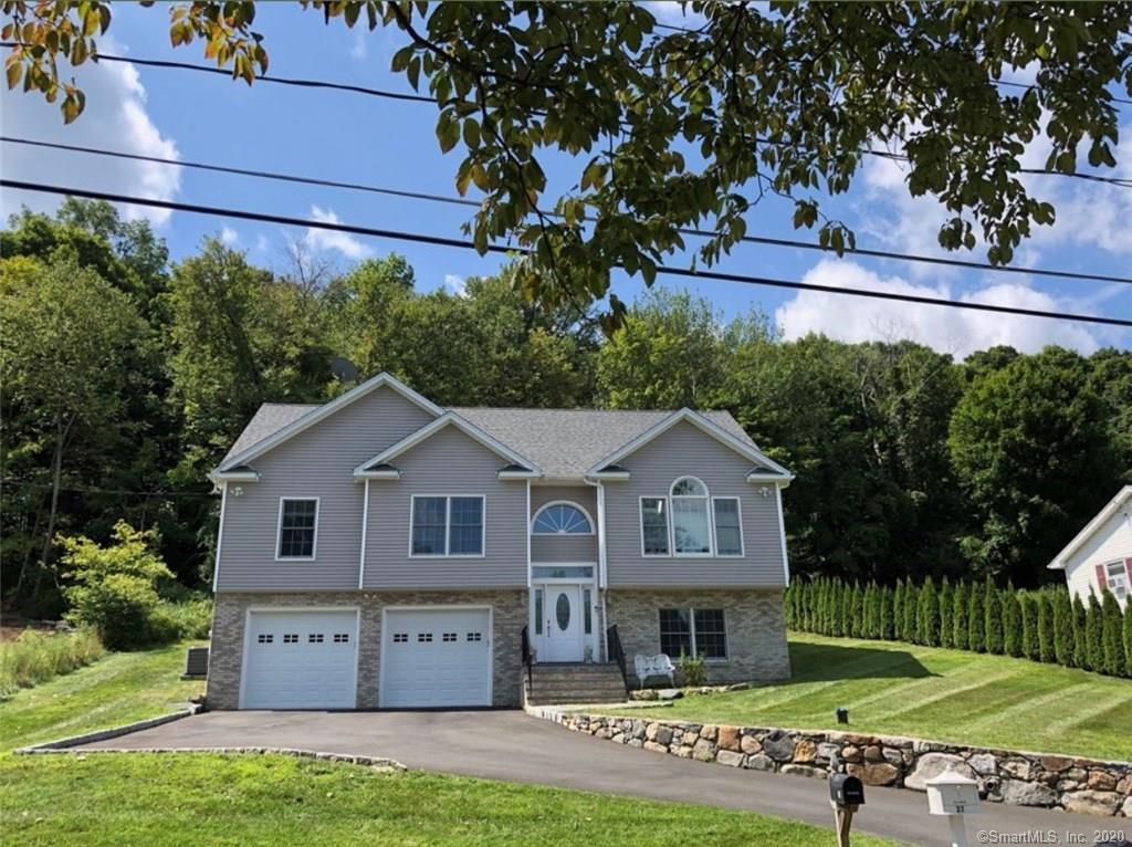 28 Hillandale Rd, Danbury, CT is a very modern, up to date single family home that contains 1,590 sq ft (2300 sqFt with finished basement) and was built in 2016. It contains 3 bedrooms and 3 gorgeous full bathrooms. Beautiful open floor plan. This is a must see home! Schedule a showing now before it's gone with the low inventory we are seeing in todays market. Take a drive by today before it's gone. Walk up showings welcomed please bring pre approval letter to show. The fully finished basement was going to be made into a 4th bedroom but the buyer as it was being built opted out of the 4th bedroom. Instead it was made into a full movie theater with a 110 inch screen and projector. It is all wired for full surround sound and there was plumbing done to build a bar if you so choose to do so. Gorgeous fireplace that really can heat up the room to enjoy at your leisure. Enjoy the latest of technology with a tankless water heater and a newly added water filtration system with water softener. You get the best of both worlds having well water and city sewer. Garage is a very large 2 car garage PLUS a whole storage room in the garage closed off. The attic is also a full stand up extremely spacious attic with tons of storage space. Easy access to all grocery stores and i-84 and 684. Great location for NYC and Westchester or Hartford commuters. Wholefoods and the Danbury Fair mall are just minutes away. Exclusions - Basement fridge, washer, dryer and microwave are not included.