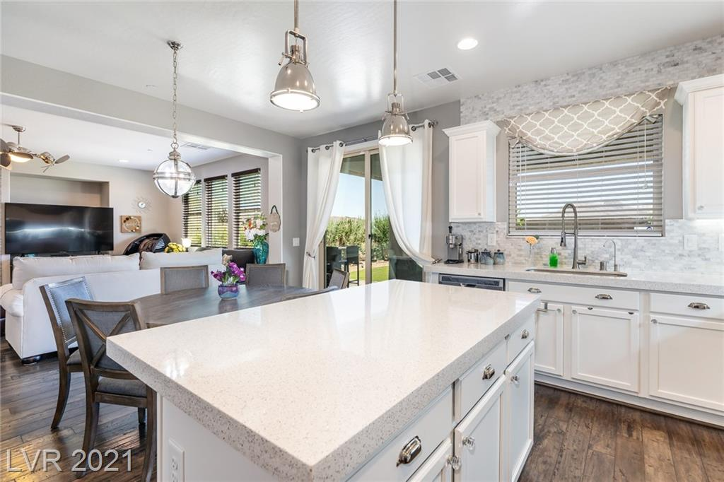 STUNNING HOME WITH MAJESTIC MOUNTAIN VIEWS - NO NEIGHBORS BEHIND * LOCATED IN TUSCANY VILLAGE - PRESTIGIOUS GOLF COURSE/GUARD GATED COMMUNITY WITH RECREATION CENTER, POOL, TENNIS COURTS, JOGGING TRAILS, BASKETBALL COURTS * THIS HOME HAS IT ALL - GOURMET KITCHEN WITH QUARTZ COUNTERTOPS, MARBLE BACKSPLASH, STAINLESS STEEL APPLIANCES, WALK-IN PANTRY AND PULL OUT KITCHEN SHELVES * 3 BEDROOMS & LARGE LOFT, DEN/OFFICE ON FIRST FLOOR *  SPACIOUS FAMILY ROOM WITH GAS FIREPLACE AND SPLIT STONE WALL * HARDWOOD FLOORING ON FIRST FLOOR * UPGRADED HVAC SYSTEM HELPS KEEP THE HOME CLEAN/REDUCE POLLUTANTS WITH THE ADDED FILTERS * LARGE WALK IN CLOSET IN PRIMARY BEDROOM * COVERED PATIO/PAVERS IN BEAUTIFULLY LANDSCAPED BACK YARD * REVERSE OSMOSIS & WATER SOFTENER * APPLIANCES STAY * UPGRADED LIGHT FIXTURES * CLOSE TO WETLANDS, HIKING AND BIKING TRAILS * GENTLY LIVED IN, WELL MAINTAINED * MUST SEE - COME FALL IN LOVE!