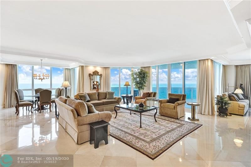 Spectacular direct ocean views! This 3 bedroom 3.5 bedroom residence has it all..floor to ceiling Impact Glass, 9' ceilings thoughout, open floorplan with endless ocean views, beautifully updated kitchen, marble flooring throughout, motorized window shades, big laundry room with storage, private foyer entry and more. Expansive balcony overlooking the ocean. Endless resort style amenities include pool, fitness center, tennis courts and valet.