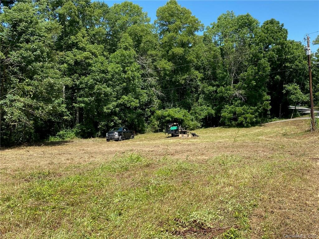 Shovel ready lot for your manufactured, modular or site built home! Level lot on the corner of Souther Rd and Fish Lake Dr. Septic permit in hand. Great Fletcher location, not far from I-26, Asheville or Hendersonville, eateries, shopping and more! Minimal restrictions to be put into place: 1,000 sf minimum, new manufactured, modular or site built on permanent foundation, no livestock & no broken down automobiles. 6 additional lots available as well (2 on Fish Lake Dr & 4 on Souther Rd)