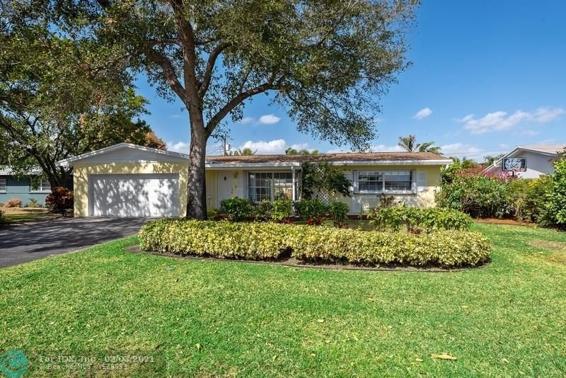 Impeccable Coral Ridge Isles pool home that checks all the boxes! Popular split bedroom plan with glass sliders from living room, master & guest bedrooms all opening out to a gorgeous all season flowering garden w/ sparkling pool and amazing covered patio that allows for entertaining in all weather. Recent updates like Brand new quartz kitchen counters and flooring (2021), newer roof (2019), dishwasher & pool pump (2020), sought-after gas cooking and gas water heater, updated bathrooms w/ frameless glass showers and tile flooring laid on diagonal throughout. Large inside laundry room and a full 2-car garage. Amazing East-Side location just 10 minutes to Lauderdale By-The-Sea beaches and fine restaurants.