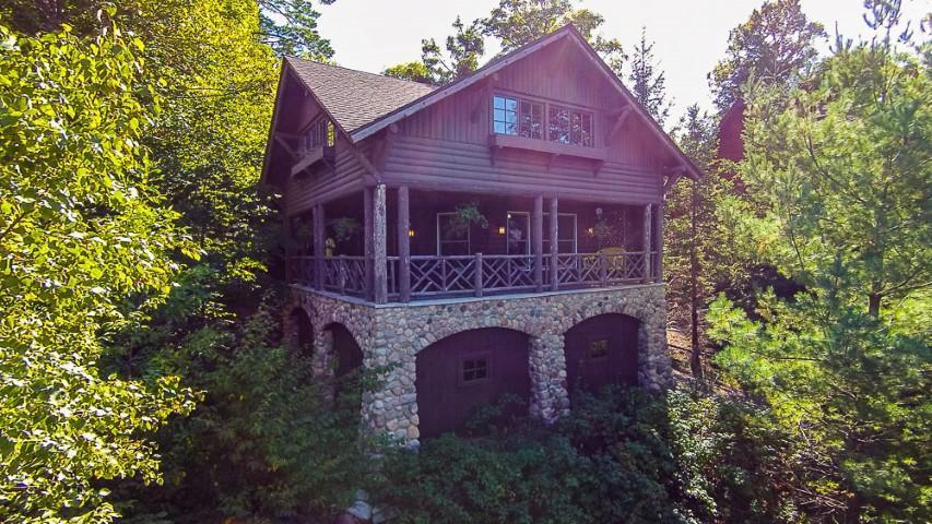 Check out this extraordinary 3 bedroom 3 bath log sided Whitefish Lake home which is situated on 101 ft of sand frontage along with 1.20 acres that are studded with mature trees. Up North feel home is being sold furnished and features Knotty pine accents, hardwood floors, lakeside living room, stainless steel appliances, upper loft for additional sleeping, unfinished lower level to customize to your liking and an attached garage. Lakeside stone boathouse offers additional storage for lake toys and has an upper deck where you can take in magnificent lake views. Sit back and relax on the perfect sand beach while you take in the warm summer sun. Adventure out on the Whitefish Chain for a fun day of boating, fishing, or swimming. Property is minutes from all the Crosslake amenities which include various shops, great restaurants and premier golf courses. Start making treasured family memories at this perfect getaway property where you can get some well-deserved peace and quiet.