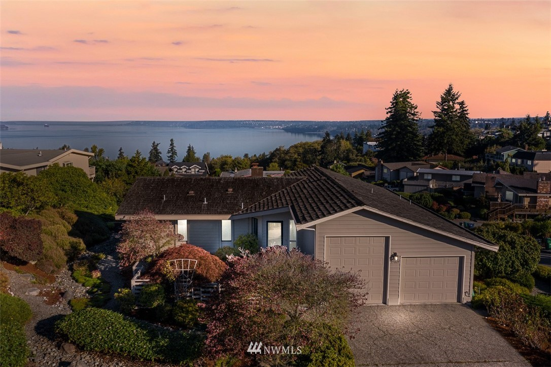 Incredible views of Puget Sound and Olympic Mountains from this 4 bedroom 2.5 bath Daylight rambler in Mar Cheri. Every room offers a protected breath-taking view.  Amenities include: vaulted ceiling, spacious living room and open kitchen to the dining room, A/C, new carpet and paint, and a large corner lot with low maintenance landscaping.  The Garage is oversized and has an RV door and workbench.  Great community with neighborhood pool, clubhouse and playground.  Make this your new home!