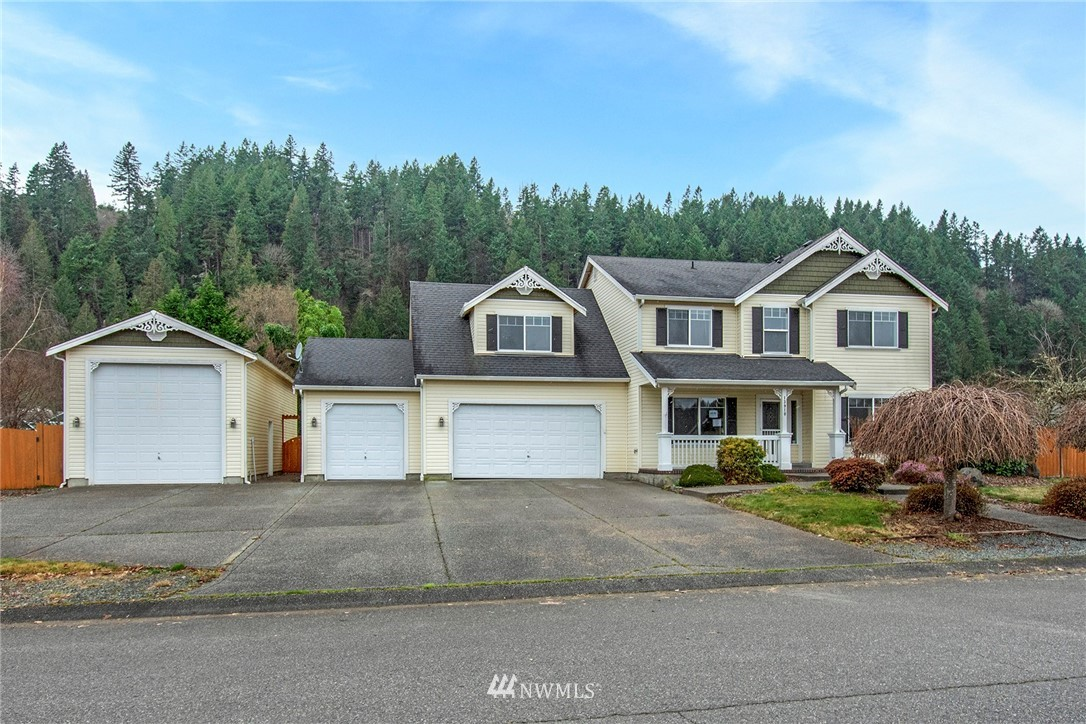 Rarely available 2 story home in Orting's Southfork Estates! Excellent curb appeal on an oversized and level 16,350 sq ft lot. Traditional floorplan featuring formal living and dining rooms and kitchen with center island that opens to family room with gas fireplace.  Engineered hardwood floors extend throughout much of the main level. 2nd floor master suite with 5-piece bath and walk-in closet.  2 additional bedrooms, laundry room and a huge bonus/rec room. Massive flat backyard with sliders to oversized patio. 3 car attached garage PLUS a detached RV parking garage.  Solid home in a small very well maintained community. Opportunity Knocks!