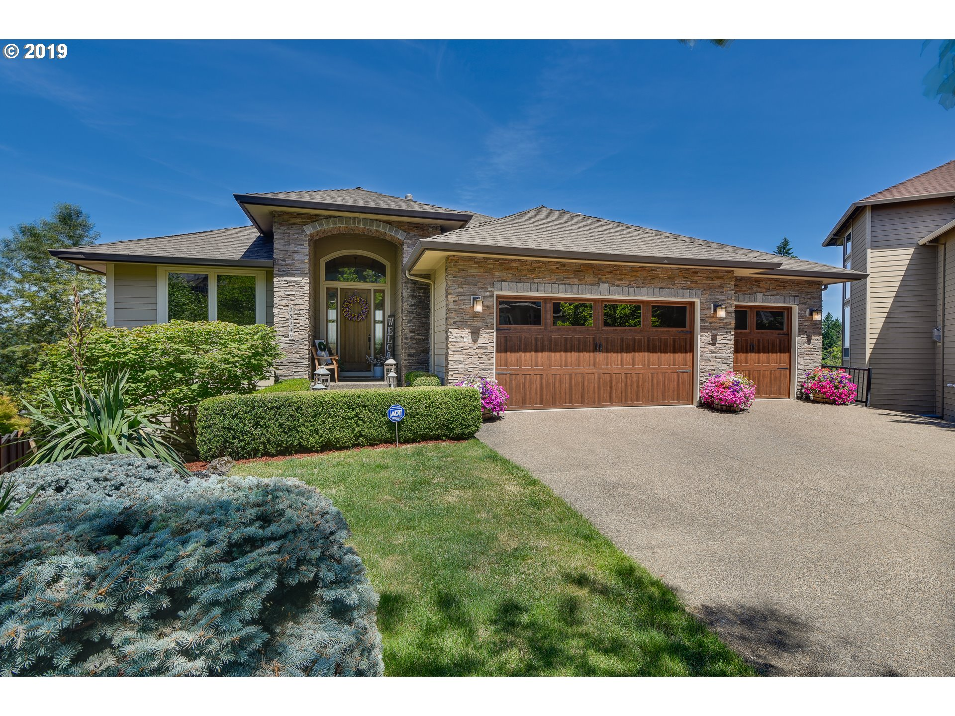 OH Sun 12-2. Stunning Jackson Hills home. Mountain and valley views greet you from almost every window. This home features: Main floor master, wine cellar, Sauna, 6 beds including 3 suites, bonus room with kitchenette and eat-bar, family room, formal living and dinning rooms, 2 fireplaces and 2 gorgeous decks affording you year-found views. Office features rich natural wood built-ins.