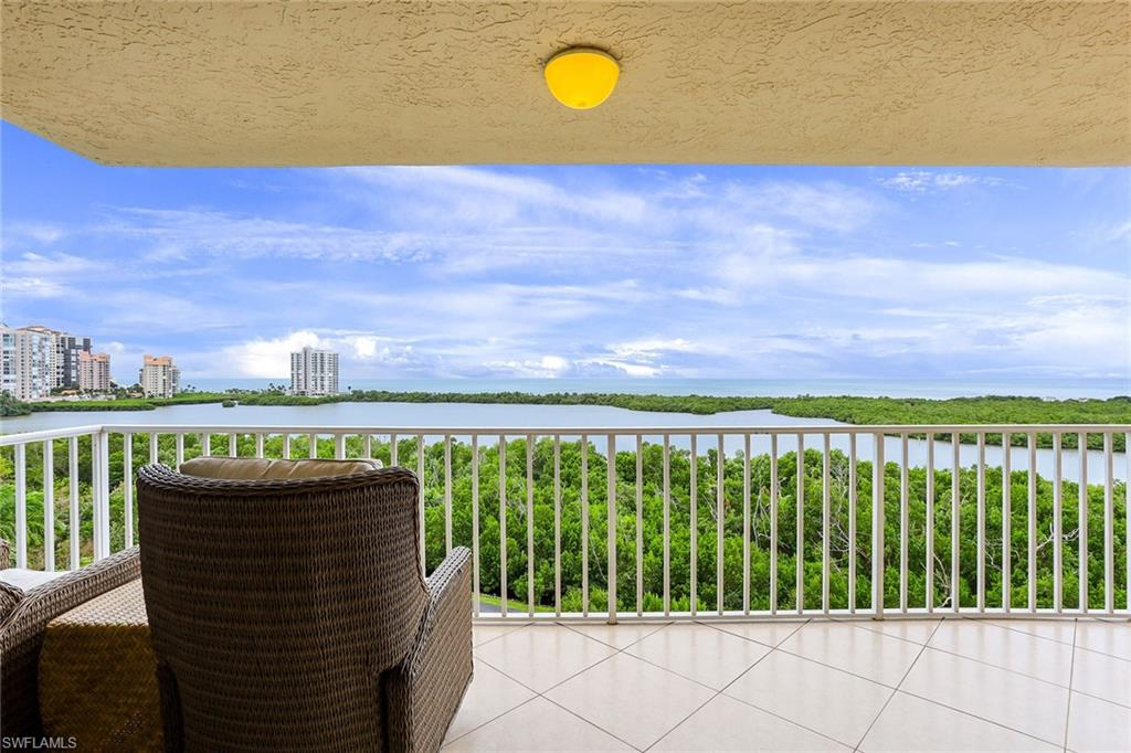 Spectacular Gulf views from this rarely available 01 unit in Pelican Bay's St. Nicole condominium. The oversized living area has been remodeled to incorporate two former porches. Enjoy breathtaking views of Clam Bay, the mangroves and the Gulf of Mexico. Unobstructed views to the west, north and south from the expansive and private open balcony. Modern, neutral décor throughout with spacious open floor plan. The third bedroom is currently used as a den, but can easily be converted back to a bedroom. St. Nicole offers easy access to the Berm and tram and Pelican Bay's private beachside restaurants and attended beachfront services. Pelican Bay membership also includes fitness and community center, 18 Har-Tru tennis courts and nature walking paths. A short distance to Waterside Shops and Artis—Naples.
